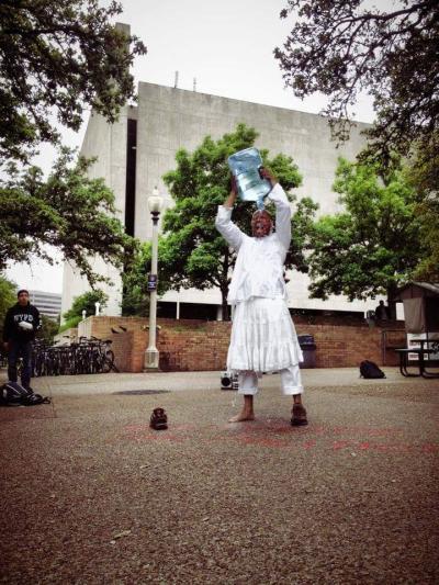 Segment from Cerqueria's I (re)suicide for political reasons at UT Austin, 2014. Photo by Gustavo Melo Cerqueria.